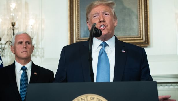 """US President Donald Trump speaks alongside Vice President Mike Pence about the mass shootings from the Diplomatic Reception Room of the White House in Washington, DC, August 5, 2019. - US President Donald Trump described mass shootings in Texas and Ohio as a """"crime against all of humanity"""" as he addressed the nation on Monday after the attacks that left in 29 people dead. """"These barbaric slaughters are... an attack upon a nation, and a crime against all of humanity,"""" he said. (Photo by SAUL LOEB / AFP)        (Photo credit should read SAUL LOEB/AFP/Getty Images)"""