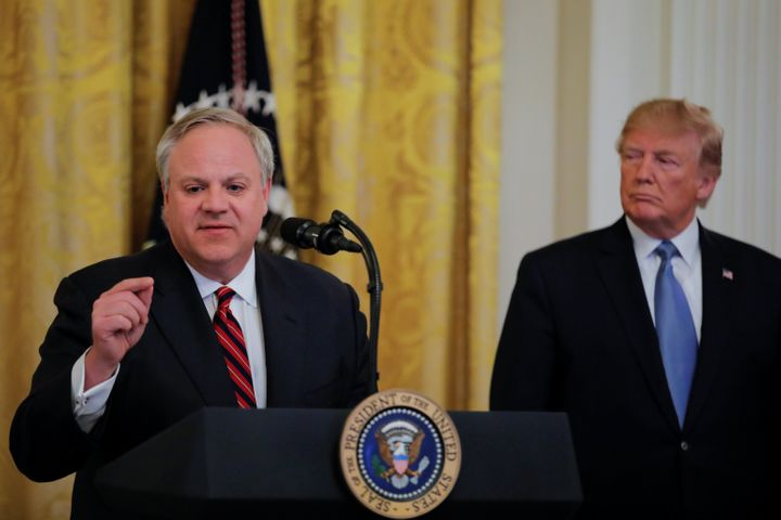 President Donald Trump listens to U.S. Interior Secretary David Bernhardt speak during an event touting the administration&rs