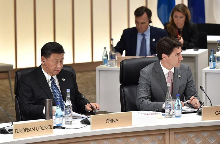 China's President Xi Jinping and Prime Minister Justin Trudeau at the G20 Summit on June 29, 2019 in Osaka, Japan.