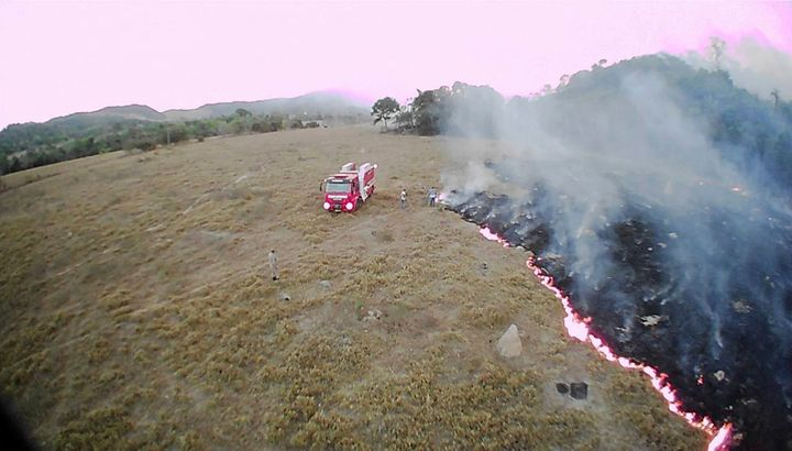 In this Aug. 20, 2019 drone photo released by the Corpo de Bombeiros de Mato Grosso, brush fires burn in Guaranta do Norte mu