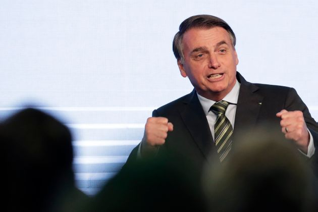 Brazil's President Jair Bolsonaro gestures after his speech to the participants of the Brazilian Steel...