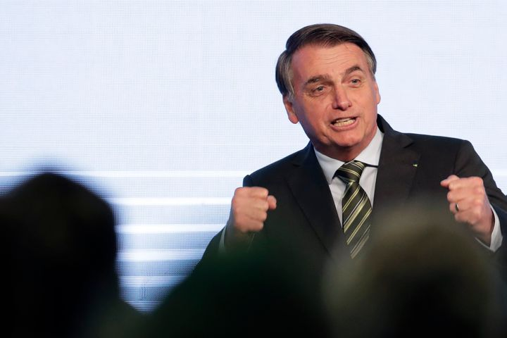 Brazil's President Jair Bolsonaro gestures after his speech to the participants of the Brazilian Steel Congress, in Brasilia,