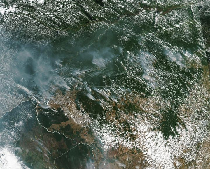 This satellite image provided by NASA on Aug. 13 shows several fires burning in Brazil;s Amazon rainforest. Brazil's National Institute for Space Research said the country has seen a record number of wildfires this year, counting 74,155 as of Tuesday.