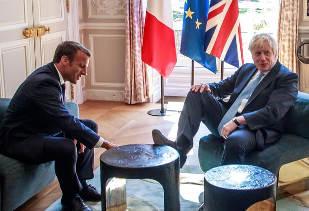 Boris Johnson Puts Foot On Table During Meeting With Emmanuel Macron – And Its All Kicked Off