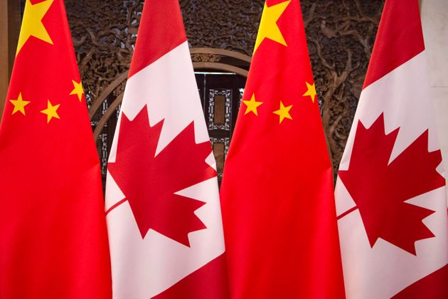 This Dec. 5, 2017, photo shows flags of Canada and China prior to a meeting between the leaders of the...