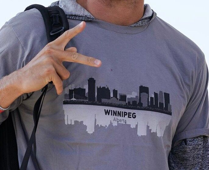 "A close-up view of AJ Cole III's shirt that mysteriously says ""Winnipeg, Alberta."""