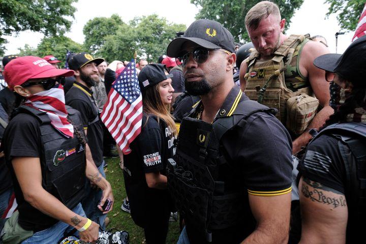 Proud Boys head Enrique Tarrio (center, wearing sunglasses at a rally last weekend in Portland, Oregon.