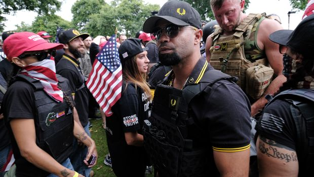 "PORTLAND, USA - AUGUST 17: Proud Boys chairman Enrique Tarrio greets protesters during ""The End Domestic Terrorism"" demonstration organized by Joe Biggs calling for an end to domestic terrorism, on August 17, 2019 in Portland, Oregon, United States.  (Photo by Alex Milan Tracy/Anadolu Agency via Getty Images)"