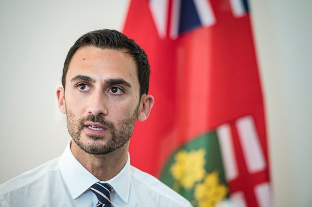 Ontario Minister of Education Stephen Lecce speaks to teachers before giving remarks in Toronto, on Aug....