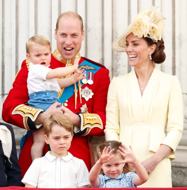 The family watch a flypast from the balcony of Buckingham Palace during Trooping the Colour, the Queen's...