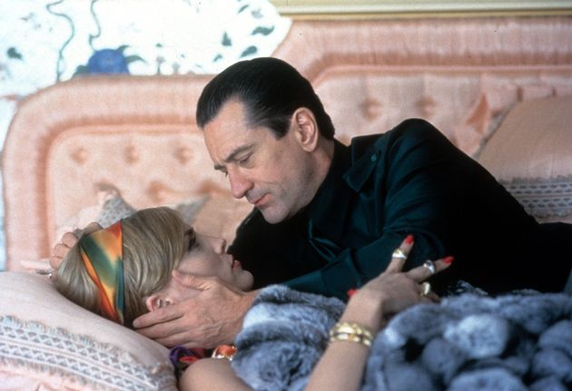 Robert De Niro and Sharon Stone having a tender moment as they lay on a bed in a scene from the film...