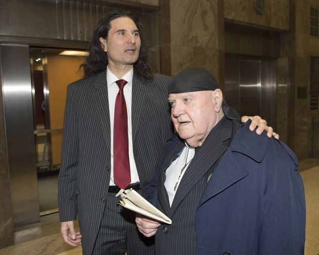 James Sears, left, and LeRoy St. Germaine leave court after being found guilty of promoting hate in Toronto...