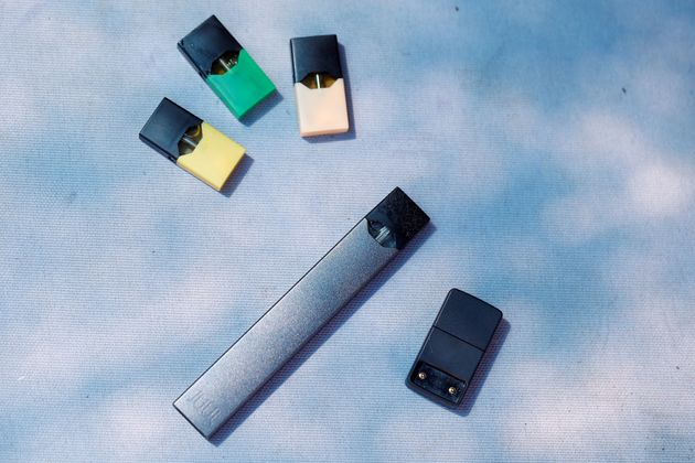 A Juul e-cigarette and pods are seen in this picture illustration taken September 16,