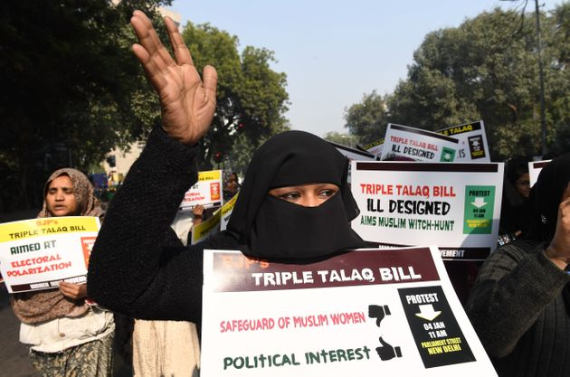 Activists of Women India Movement (WIM) shout slogans as they hold placards against the 'Triple Talaq...