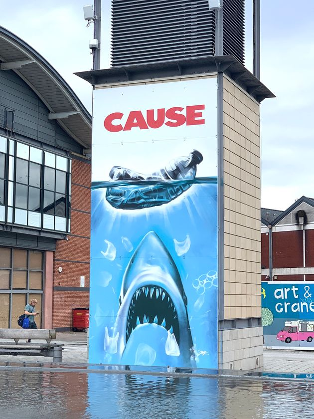 Street Artist Jody Thomas Reworks Iconic 'Jaws' Poster In Swipe At Plastic Pollution