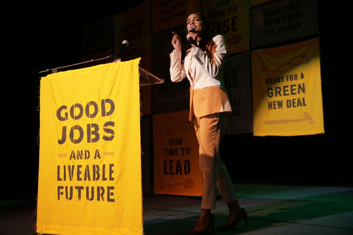 "Rep. Alexandria Ocasio-Cortez (D-N.Y.) speaks at a Green New Deal rally in May, calling for ""good jobs"" and a safe climate.&n"
