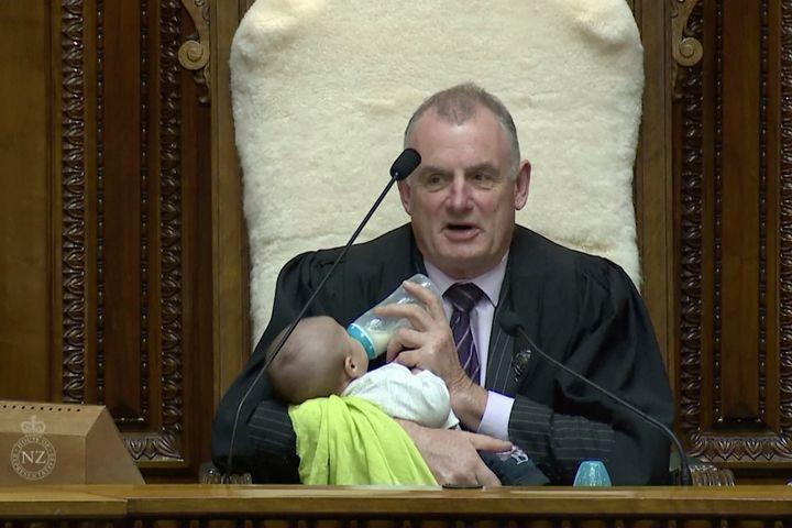 Speaker Trevor Mallard shows good bottle-feeding form during a debate Wednesday.