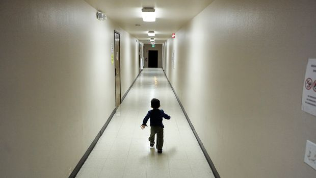 FILE - In this Dec. 11, 2018 file photo, an asylum-seeking boy from Central America runs down a hallway after arriving from an immigration detention center to a shelter in San Diego. A federal judge who ordered that more than 2,700 children be reunited with their parents on Friday, March 8, 2019, expanded his authority to potentially thousands more children who were separated at the border earlier during the Trump administration.  (AP Photo/Gregory Bull, File)