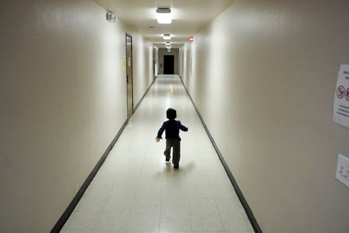 In this Dec. 11, 2018, file photo, an asylum-seeking boy from Central America runs down a hallway after arriving from an immi