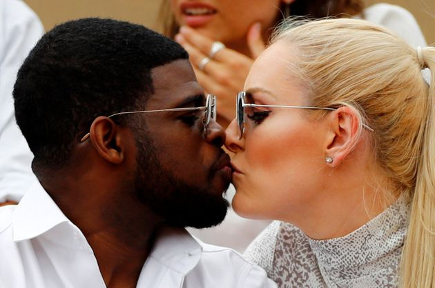 The couple steal a kiss at the French Open in June 2019 [Insert joke here about the score being