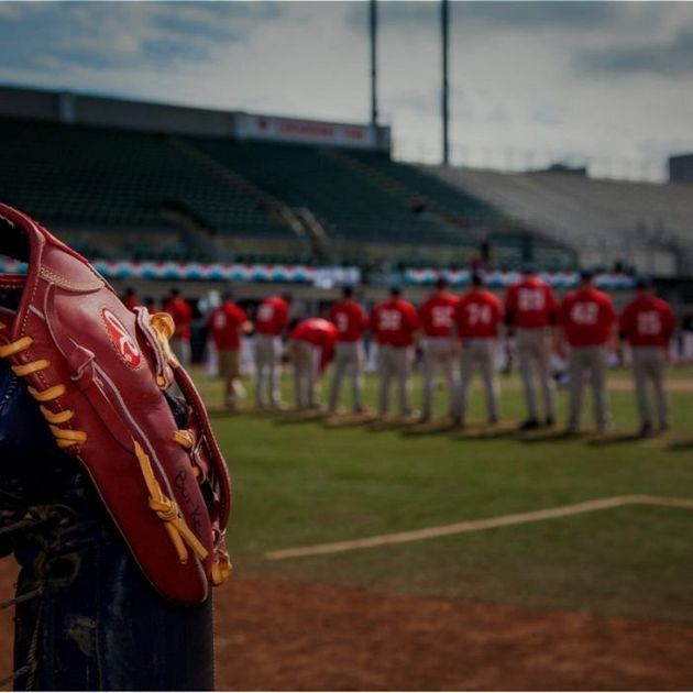 Players line up at the beginning of an 85-hour baseball game in Edmonton Aug.