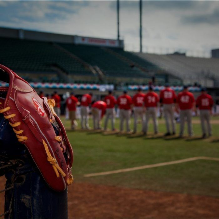 Players line up at the beginning of an 85-hour baseball game in Edmonton Aug. 22.