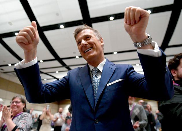 People's Party of Canada leader Maxime Bernier reacts after a musical performance at the PPC National...
