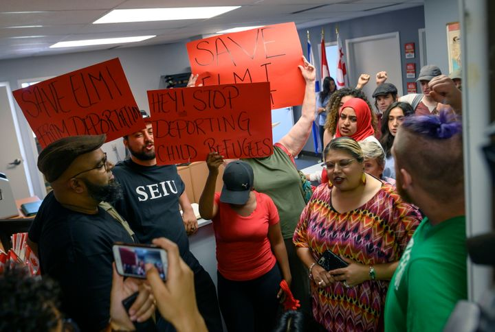Demonstrators chant in MP Andy Fillmore's constituency office advocating for a stay on the deportation of Abdilahi Elmi to Somalia during a protest in Halifax on Tuesday.