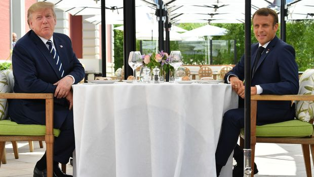 US President Donald Trump (L) sits to lunch with French President Emmanuel Macron at the Hotel du Palais in Biarritz, south-west France on August 24, 2019, on the first day of the annual G7 Summit attended by the leaders of the world's seven richest democracies, Britain, Canada, France, Germany, Italy, Japan and the United States. (Photo by Nicholas Kamm / AFP)        (Photo credit should read NICHOLAS KAMM/AFP/Getty Images)