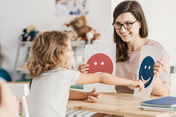 A counsellor works with a child diagnosed with autism.