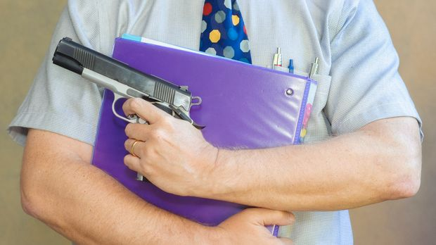 Worried about violence at work, a teacher brings a loaded gun to his classroom to protect himself and his students