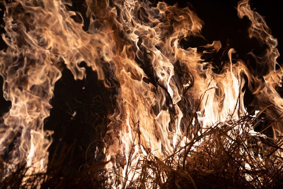Description: A fire burns a field on a farm in the Nova Santa Helena municipality, in the state...