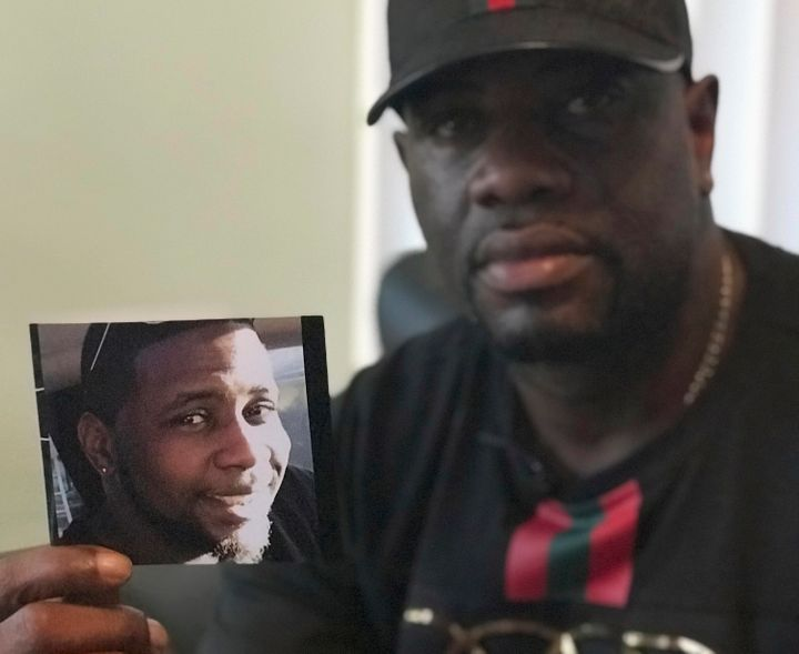 In this Aug. 7, 2018, file photo, Michael McGlockton holds a photo of his son, Markeis McGlockton, in Clearwater, Florida.