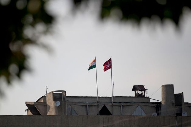 In this Friday, Aug. 9, 2019, photo, an Indian national flag, left, flies next to a Jammu and Kashmir...
