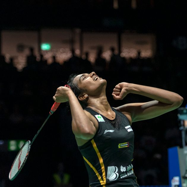 India's Pusarla V. Sindhu cheers after winning her women's singles final match against Japan's Nozomi...