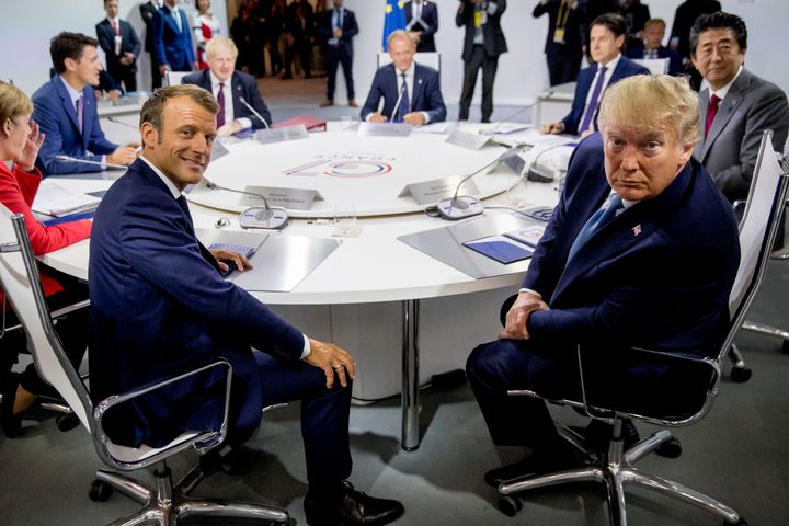 French President Emmanuel Macron, center left, and President Donald Trump, center right, participate in a G-7 Working Session