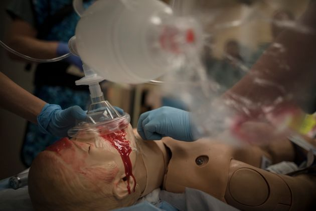 Medical staff tend to a mannequin in the trauma bay during a mass casualty simulation at St. Michael's...