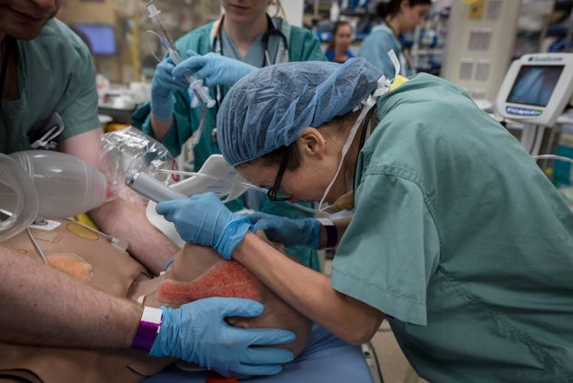 Dr. Clare Toguri performs a procedure on a medical mannequin in the trauma bay during a mass casualty...