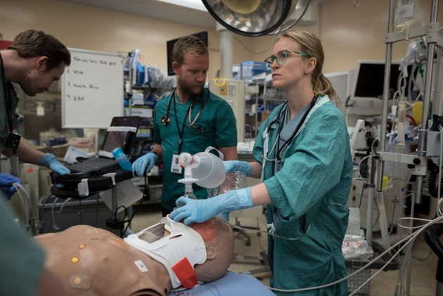 Alison Bucik, a graduate respiratory therapist, performs a procedure on a medical mannequin in the trauma...
