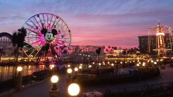 Anahiem, California, USA - December 21, 2014: Tourists wander around Disney's California Adventure at dusk. California Adventure is a park located adjacent to Disneyland, a major tourist attraction in Anaheim.