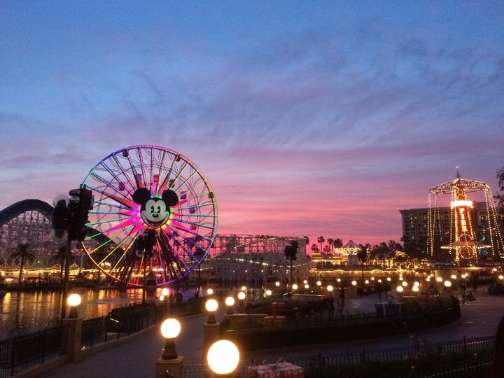 Tourists wander around Disney's California Adventure located adjacent to Disneyland, a major tourist attraction in Anaheim. T
