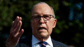 White House chief economic adviser Larry Kudlow talks with reporters outside the White House, Tuesday, Aug. 6, 2019, in Washington. (AP Photo/Evan Vucci)