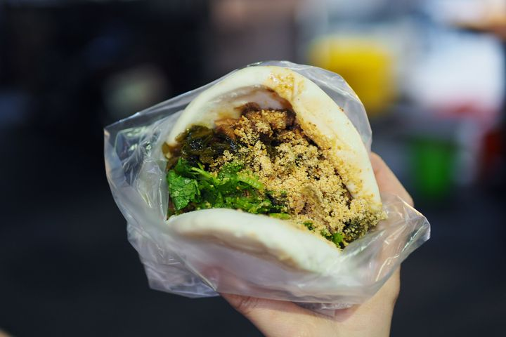 Pork belly gua bao made with a traditional Taiwanese steamed bun and stewed pork belly.