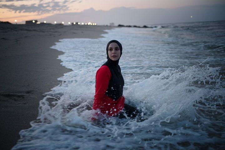 Manar Hussein wears a burkini at a beach in New Jersey in June.