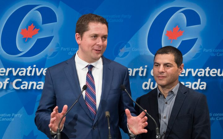 Conservative Leader Andrew Scheer and his Quebec lieutenant Alain Rayes speak to reporters in Saint-Hyacinthe, Que. on May 13, 2018.