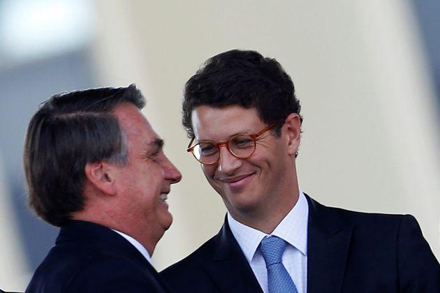 Brazil's President Jair Bolsonaro and Brazil's Environment Minister Ricardo Salles attend an Soldier's...