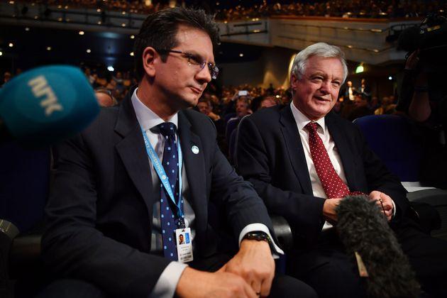 Conservative MP's Steve Baker (L) and David Davis wait for a speech by British politician Boris Johnson...