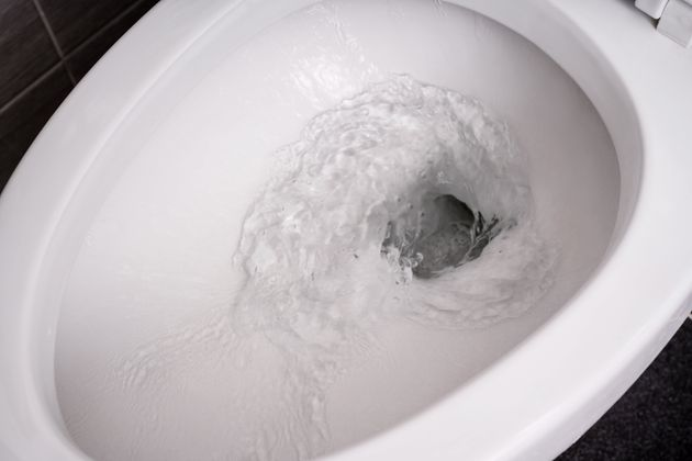 Water is flushed down a toilet in this image. A new study suggests cannabis levels in wastewater were...