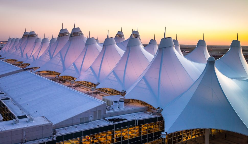 DENVER, CO - APRIL 13: The unusual fabric-covered tent (or teepee) construction of the main terminal, designed to be reflective of the nearby snow-capped Rocky Mountains, is viewed from the Westin Hotel at Denver International Airport on April 13, 2017, in Denver, Colorado. Located 25 miles from downtown, Denver International Airport, a United Airlines hub, has grown to become one the largest airports in the United States. (Photo by George Rose/Getty Images)