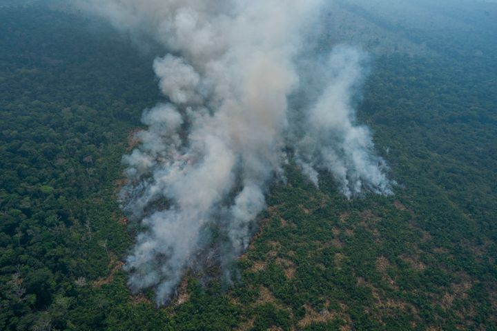 Fire consumes an area near Porto Velho, Brazil, Friday, Aug. 23, 2019. Brazilian state experts have reported a record of near